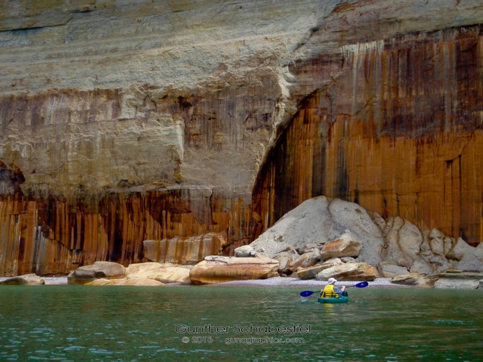 Kayaking along rocky cliffs